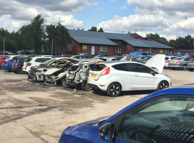 Burned out vehicles in the car park of HMP Birmingham
