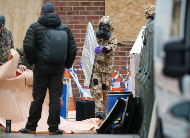 A window is removed by a member of the military as work continues on the home of former Russian spy Sergei Skripal in Salisbury, Wiltshire (Andrew Matthews/PA)