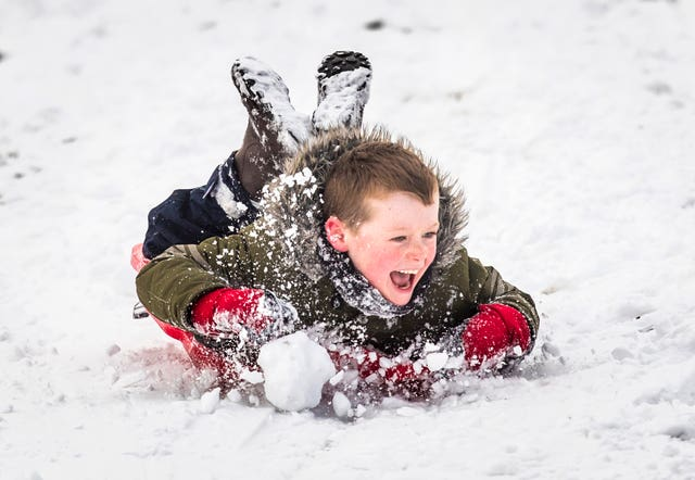 Luke Clarke, seven, sledging in the snow in Chapel-en-le-Frith, Derbyshire (Danny Lawson/PA)