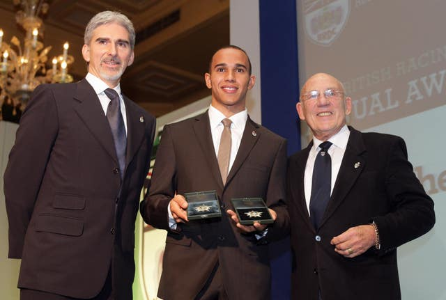 Damon Hill, left, with Lewis Hamilton, centre, and Sir Stirling Moss