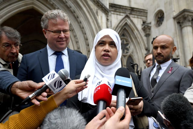Shelina Begum and Mohammed Raqeeb (right) outside the Royal Courts of Justice in London