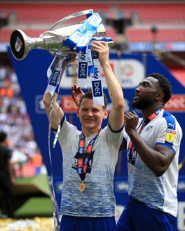 Tranmere's Connor Jennings celebrates with the trophy after the Sky Bet League Two play-off final at Wembley