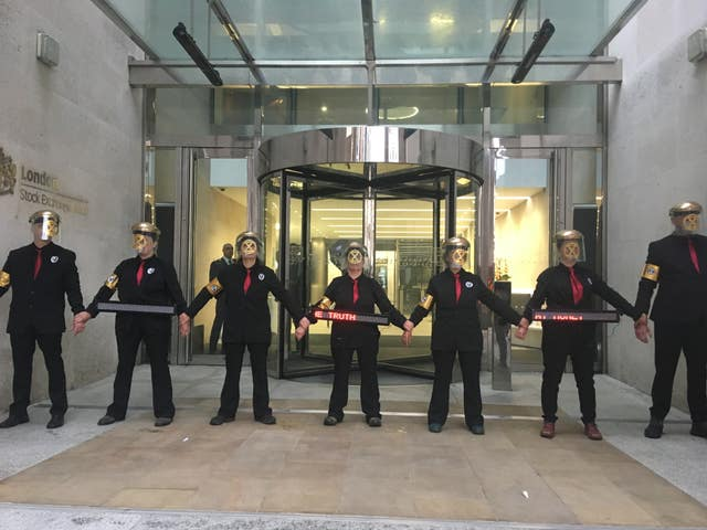Environment protesters from Extinction Rebellion glue themselves to London Stock Exchange