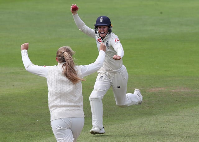 England's Tammy Beaumont celebrates taking the catch of Beth Mooney but Australia retained the Ashes