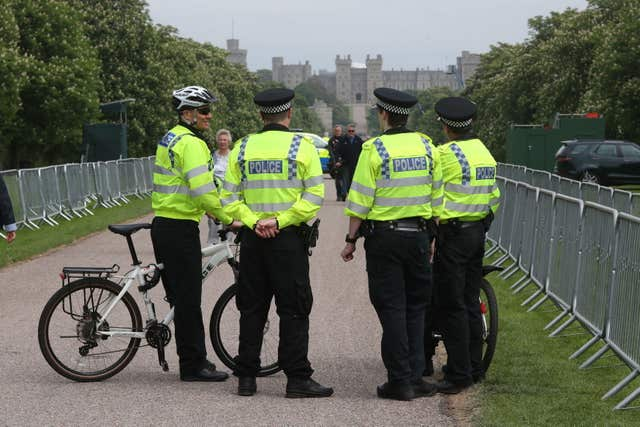 Police officers outside Windsor Castle (Jonathan Brady/PA)