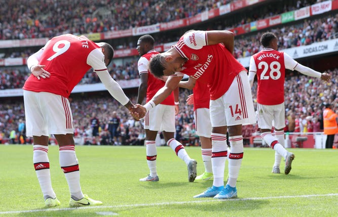 Arsenal's Pierre-Emerick Aubameyang celebrates scoring his side's second goal of the game with team-mate Alexandre Lacazette