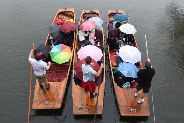 People on punts with umbrellas
