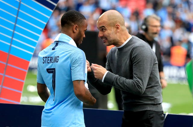 Pep Guardiola, right, has a word with Raheem Sterling