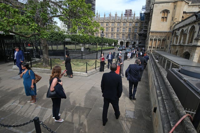 Members of Parliament queue outside the House of Commons (Jonathan Brady/PA)