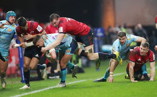 Exeter's Henry Slade is knocked into touch by Munster's Tommy O'Donnell (Niall Carson/PA).