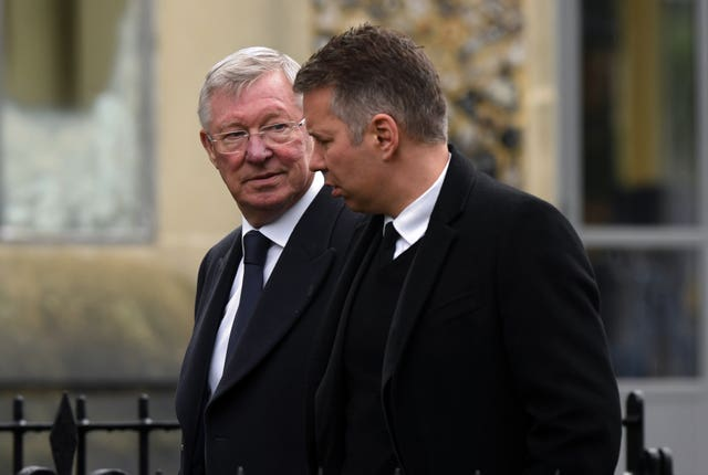 Darren Ferguson (right) has followed his father Sir Alex (left) into football management