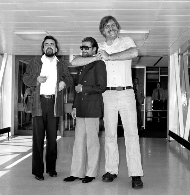 Actors Michael Lonsdale, Roger Moore and Richard Kiel, aka Hugo Drax, James Bond and Jaws, at London's Heathrow Airport (PA)