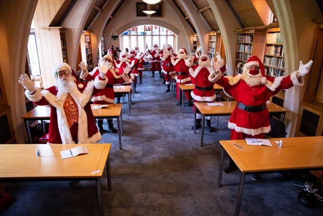 Santas at The Ministry of Fun's Summer School at Southwark Cathedral, London which aims to create COVID-safe Christmas grottos by teaching Father Christmases how to appear safely in person whilst maintaining the Christmas magic