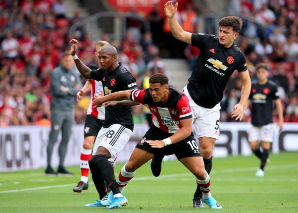 Southampton's Che Adams (centre) clashes with Ashley Young (left) and Maguire