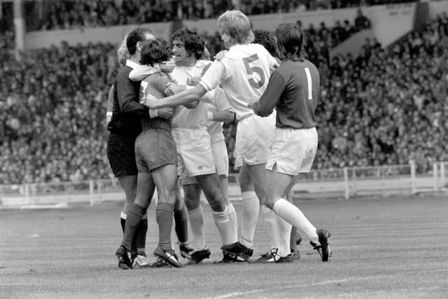 Hunter and referee Reg Matthewson try to break up a fight between Leeds midfielder Billy Bremner and Liverpool forward Kevin Keegan during the 1974 Charity Shield at Wembley