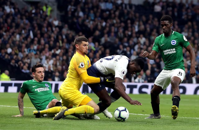 Victor Wanyama, centre, battles for possession with Brighton keeper Mat Ryan
