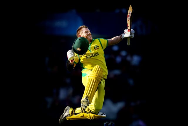 Australia opener David Warner punches the air following his century against South Africa at the Cricket World Cup. The left-hander, who completed a 12-month ban for ball tampering before the tournament, recorded the biggest innings score of the competition (166 against Bangladesh) and finished as the second highest run scorer (647) behind India's Rohit Sharma