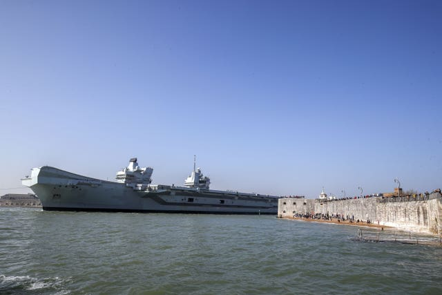 The Royal Navy aircraft carrier HMS Queen Elizabeth leaves Portsmouth Naval Base in Hampshire as it sets sail for exercises at sea