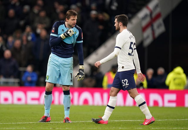 Tim Krul, left, admitted to playing with Troy Parrott's mind ahead of his penalty