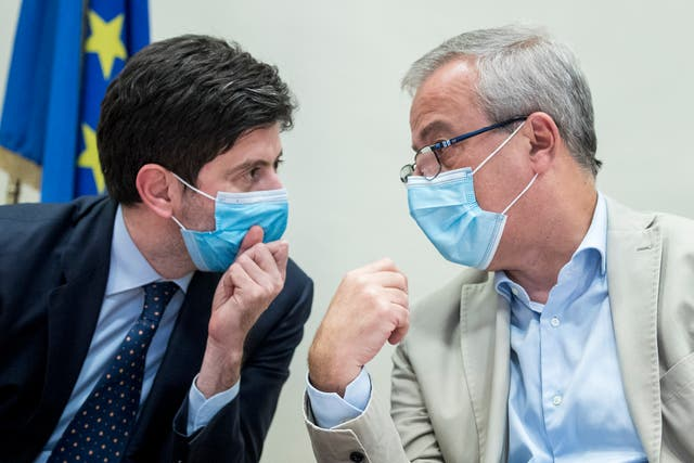Italian health minister Roberto Speranza, left, with Dr Franco Locatelli, a key government adviser on the coronavirus pandemic