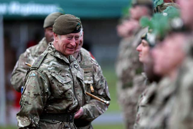 The Prince of Wales presents medals to troops from the Mercian Regiment during a visit to their Bulford Camp base in Wiltshire. (Peter Nicholls/PA)