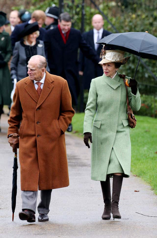 Philip and the Princess Royal leave the morning Christmas Day service at St Mary Magdalene Church on the Sandringham estate
