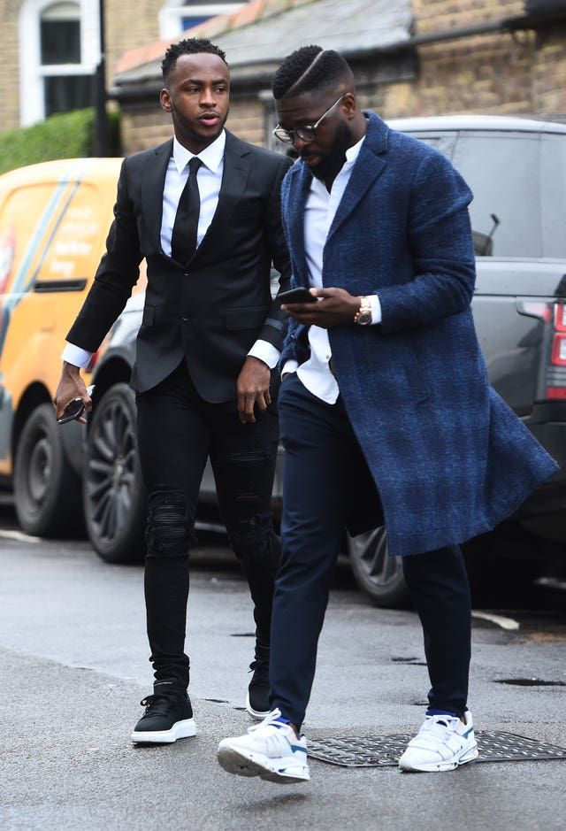 Stoke City forward Saido Berahino,left, arriving at Highbury Corner Magistrates' Court