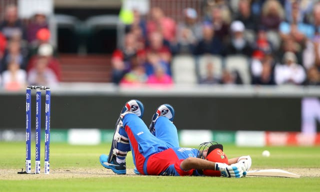 Hashmatullah Shahidi lies on the ground at Old Trafford