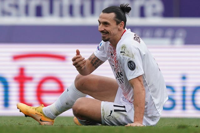 Zlatan Ibrahimovic sits on the grass in Bologna