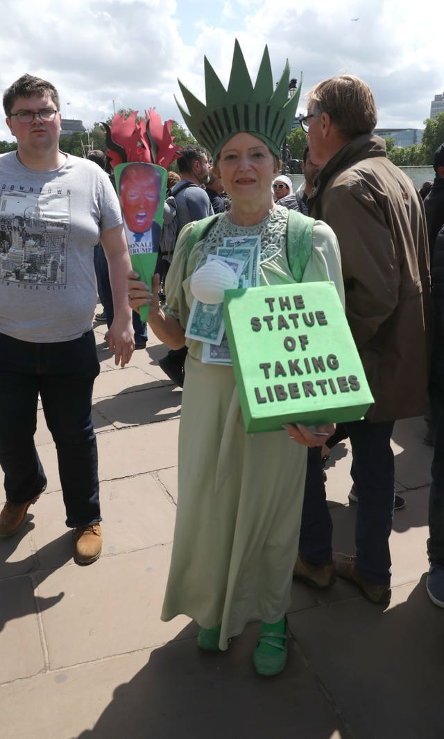 A protester outside Buckingham Palace on the first day of a state visit to the UK by US President Donald Trump