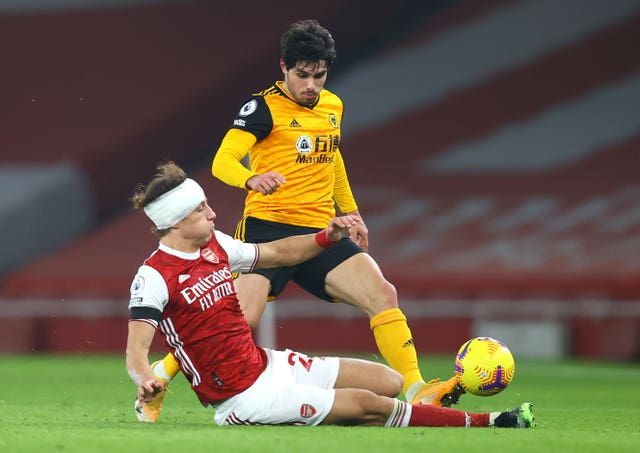 Arsenal's David Luiz (left) returned to action with his head bandaged
