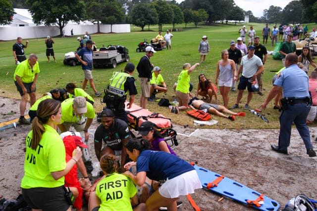 Spectators were tended to after a lightning strike on the East Lake Golf Club.