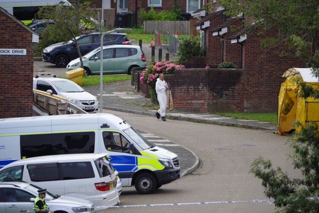A forensic officer carries an evidence bag in Biddick Drive in the Keyham area of Plymouth, Devon (ben Birchall/PA)