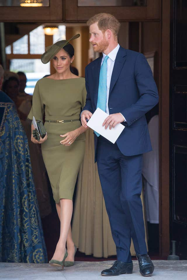 The Duke and Duchess of Sussex depart after attending the christening of Prince Louis at the Chapel Royal, St James's Palace, London.
