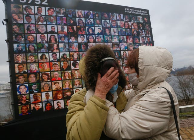 Relatives react at a memorial in Kyiv, Ukraine, Friday, Jan. 8, 2021, for the victims of a Ukrainian 737-800 plane crash on the outskirts of Tehran (Efrem Lukatsky/AP)