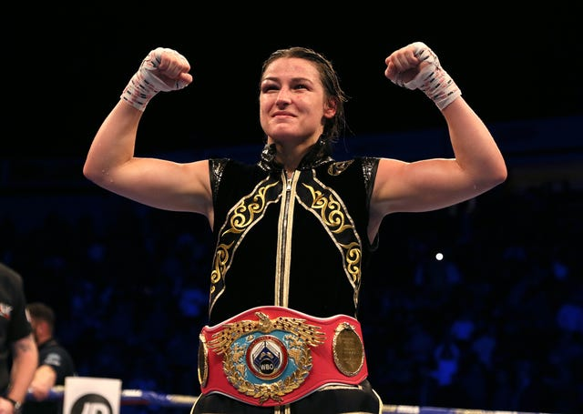 Katie Taylor celebrated becoming a two-weight world champion with victory against Christina Lindardatou in their WBO super-lightweight title bout in Manchester on Saturday night