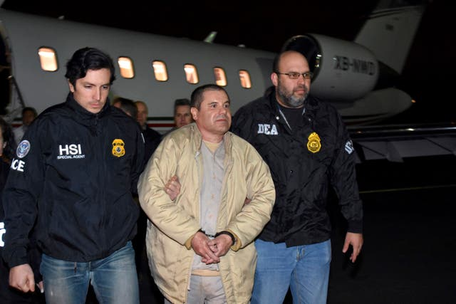 Guzman is escorted from a plance after his arrival in the US in 2017