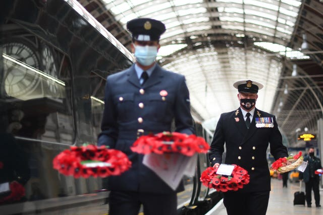The wreaths arrived at Paddington station in time for a remembrance service at 11am (Victoria Jones/PA)
