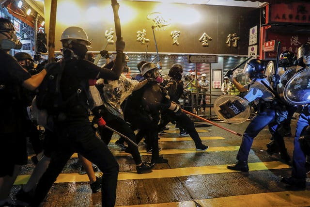 Police officers clash with demonstrators