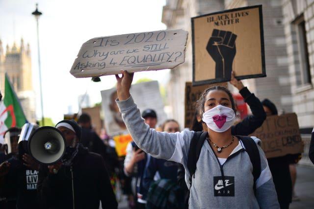 Black Lives Matter demonstrators walking to Downing Street