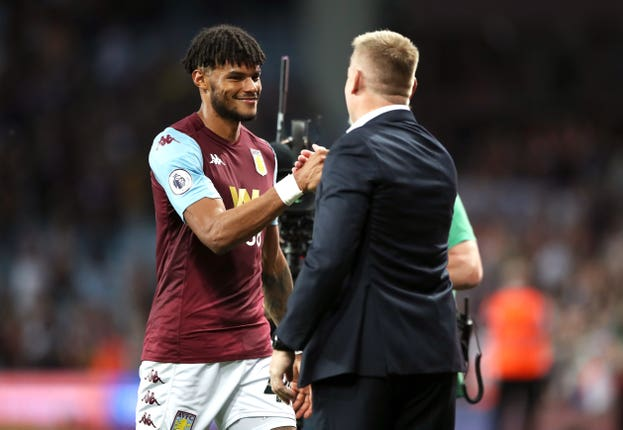 Tyrone Mings, left, celebrates victory with manager Dean Smith