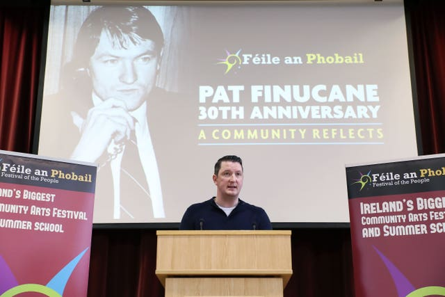 John Finucane speaking at St Mary's University College Belfast at an event to mark the 30th anniversary of the death of his father, Belfast solicitor Pat Finucane (Kelvin Boyes/AP)