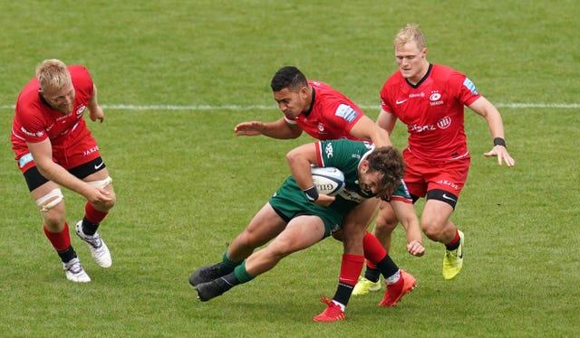 London Irish's James Stokes is tackled down by Saracens fly-half Manu Vunipola
