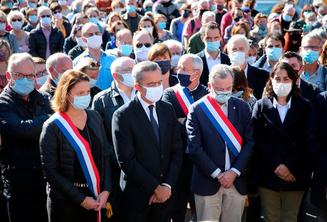 Local officials observed a minute's silence in Bayonne, southwestern France, in memory of teacher Samuel Paty