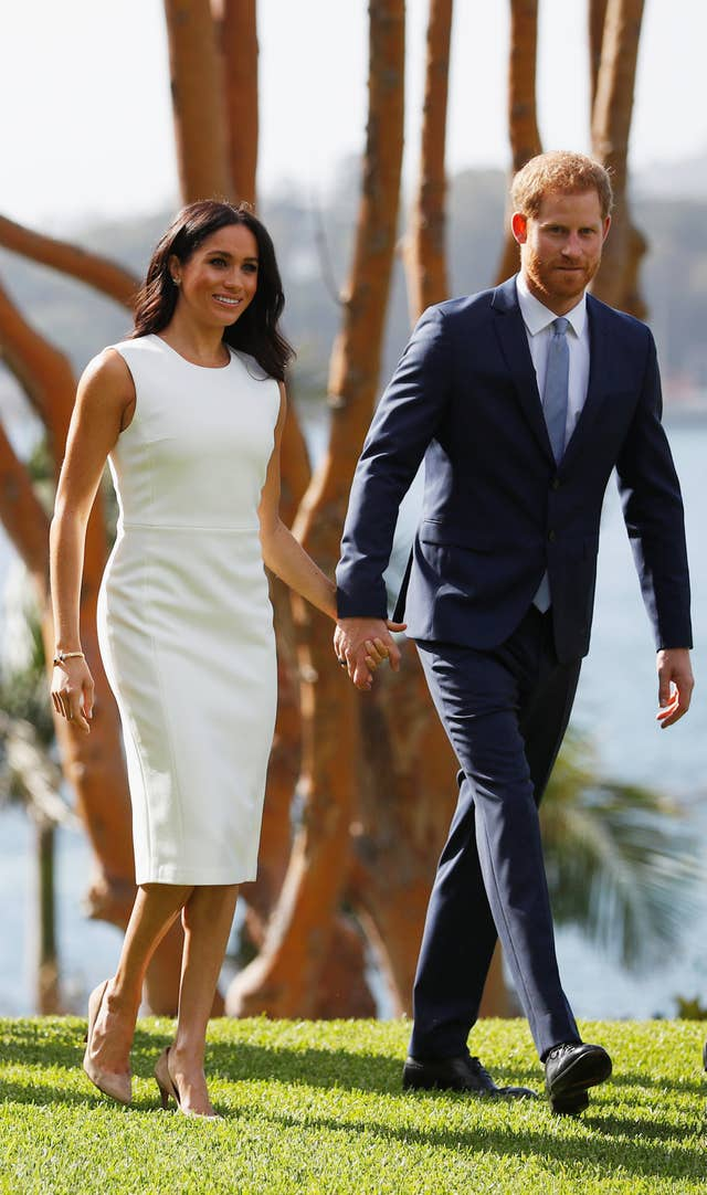 The Duchess of Sussex wore a white Karen Gee dress on day one of the royal tour