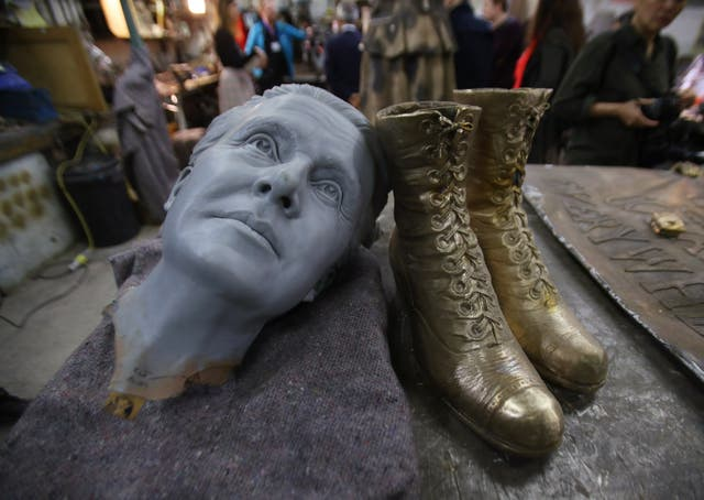 A 3D-printed head - used as a starting point to model the finished head of the statue - alongside a pair of boots that were fitted to an unfinished statue of suffragist leader Millicent Fawcett (Yui Mok/PA)