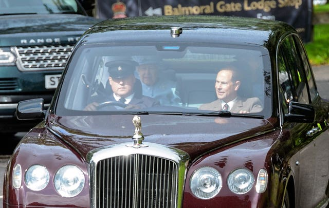 Prince Andrew sits next to chauffeur