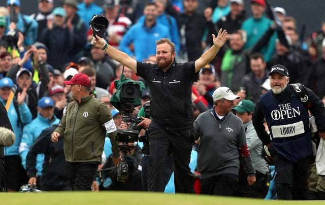 Shane Lowry celebrates on the 18th