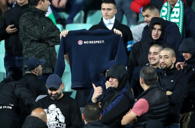 A Bulgaria fan holds up a 'No Respect' sweatshirt