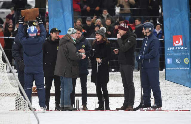 Kate and William meet a group of bandy hockey players (Victoria Jones/PA)
